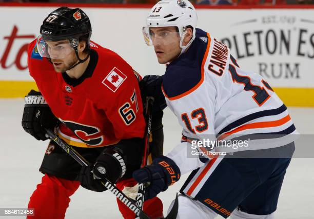 Michael Frolik of the Calgary Flames faces off against Michael Cammalleri of the Edmonton Oilers at Scotiabank Saddledome on December 2 2017 in...
