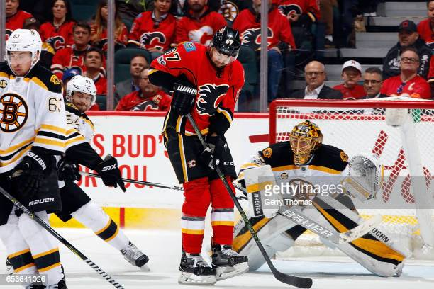 Michael Frolik of the Calgary Flames skates against Anton Khudobin of the Boston Bruins during an NHL game on March 15 2017 at the Scotiabank...