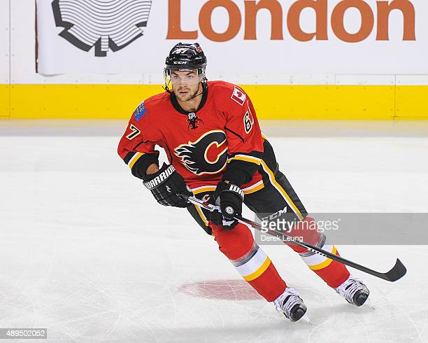 Michael Frolik of the Calgary Flames skates against the Edmonton Oilers during a preseason NHL game at Scotiabank Saddledome on September 21 2015 in...