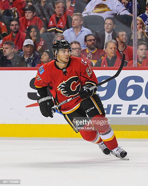 Michael Frolik of the Calgary Flames skates against the Vancouver Canucks in the season opener at Scotiabank Saddledome on October 7 2015 in Calgary...
