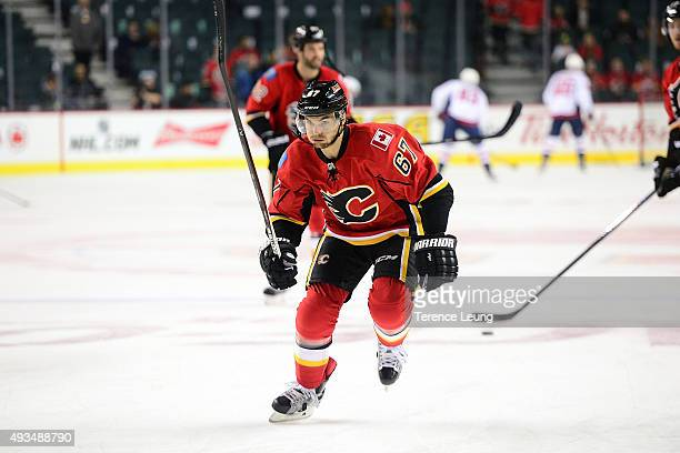 Michael Frolik of the Calgary Flames skates in the warmup against the Washington Capitals during an NHL game at Scotiabank Saddledome on October 20...