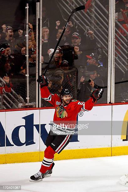 Michael Frolik of the Chicago Blackhawks celebrates in the third period after Johnny Oduya of the Chicago Blackhawks scored a goal against the Boston...
