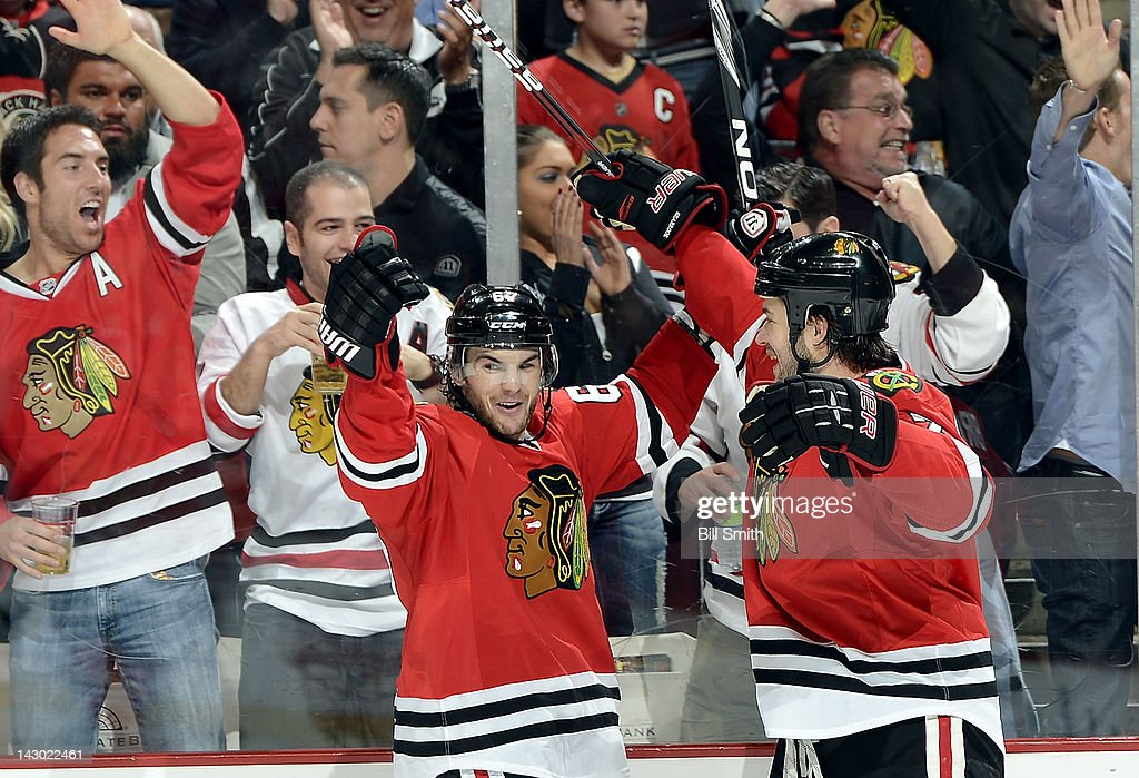 <a gi-track='captionPersonalityLinkClicked' href=/galleries/search?phrase=Michael+Frolik&family=editorial&specificpeople=537965 ng-click='$event.stopPropagation()'>Michael Frolik</a> #67 of the Chicago Blackhawks celebrates with teammate <a gi-track='captionPersonalityLinkClicked' href=/galleries/search?phrase=Brent+Seabrook&family=editorial&specificpeople=638862 ng-click='$event.stopPropagation()'>Brent Seabrook</a> #7 after scoring against the Phoenix Coyotes during Game Three of the Western Conference Quarterfinals during the 2012 NHL Stanley Cup Playoffs at the United Center on April 17, 2012 in Chicago, Illinois.
