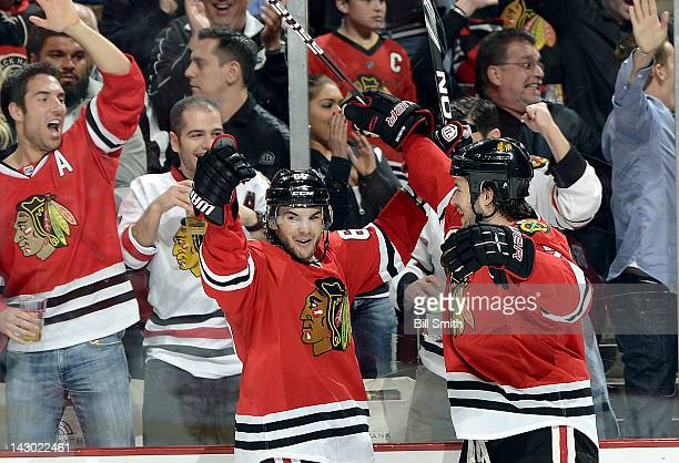 Michael Frolik of the Chicago Blackhawks celebrates with teammate Brent Seabrook after scoring against the Phoenix Coyotes during Game Three of the...