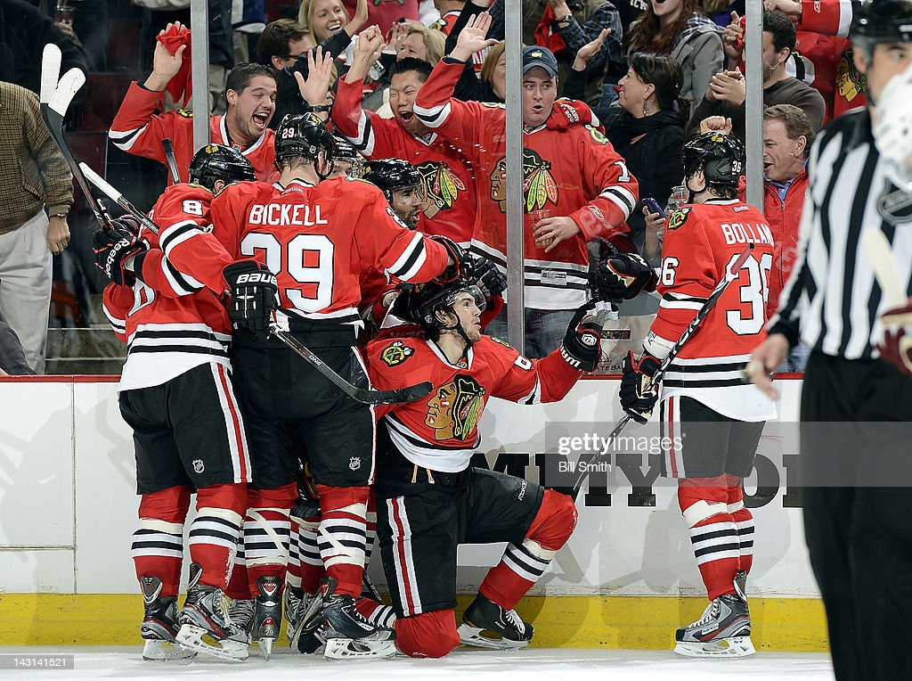 <a gi-track='captionPersonalityLinkClicked' href=/galleries/search?phrase=Michael+Frolik&family=editorial&specificpeople=537965 ng-click='$event.stopPropagation()'>Michael Frolik</a> #67 of the Chicago Blackhawks celebrates with teammates after scoring against the Phoenix Coyotes and tying the game with a few minutes left in the third, during Game Four of the Western Conference Quarterfinals during the 2012 NHL Stanley Cup Playoffs at the United Center on April 19, 2012 in Chicago, Illinois.