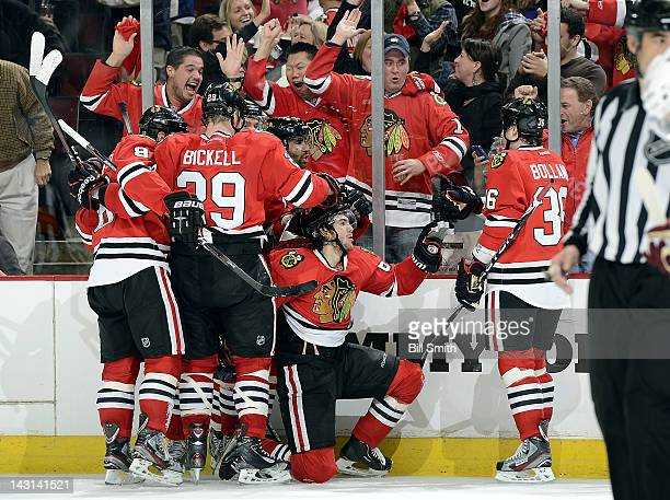 Michael Frolik of the Chicago Blackhawks celebrates with teammates after scoring against the Phoenix Coyotes and tying the game with a few minutes...