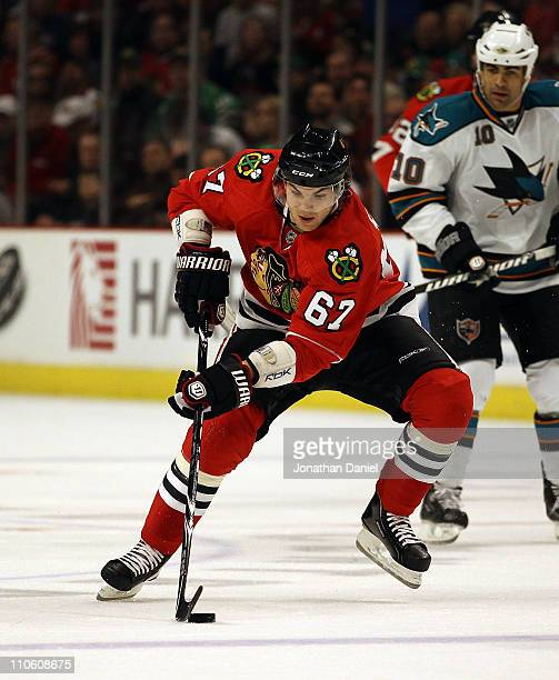 Michael Frolik of the Chicago Blackhawks controls the puck against the San Jose Sharks at the United Center on March 14 2011 in Chicago Illinois The...