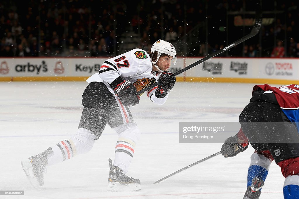 <a gi-track='captionPersonalityLinkClicked' href=/galleries/search?phrase=Michael+Frolik&family=editorial&specificpeople=537965 ng-click='$event.stopPropagation()'>Michael Frolik</a> #67 of the Chicago Blackhawks takes a shot against the Colorado Avalanche at the Pepsi Center on March 18, 2013 in Denver, Colorado. The Blackhawks defeated the Avalanche 5-2.