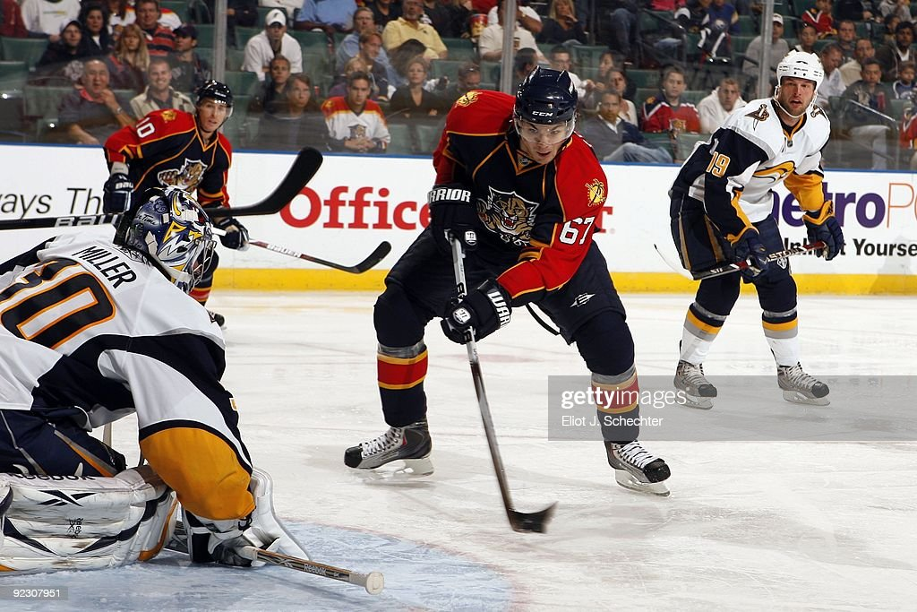 Michael Frolik of the Florida Panthers takes a shot against Goaltender Ryan Miller of the Buffalo Sabres at the BankAtlantic Center on October 21...