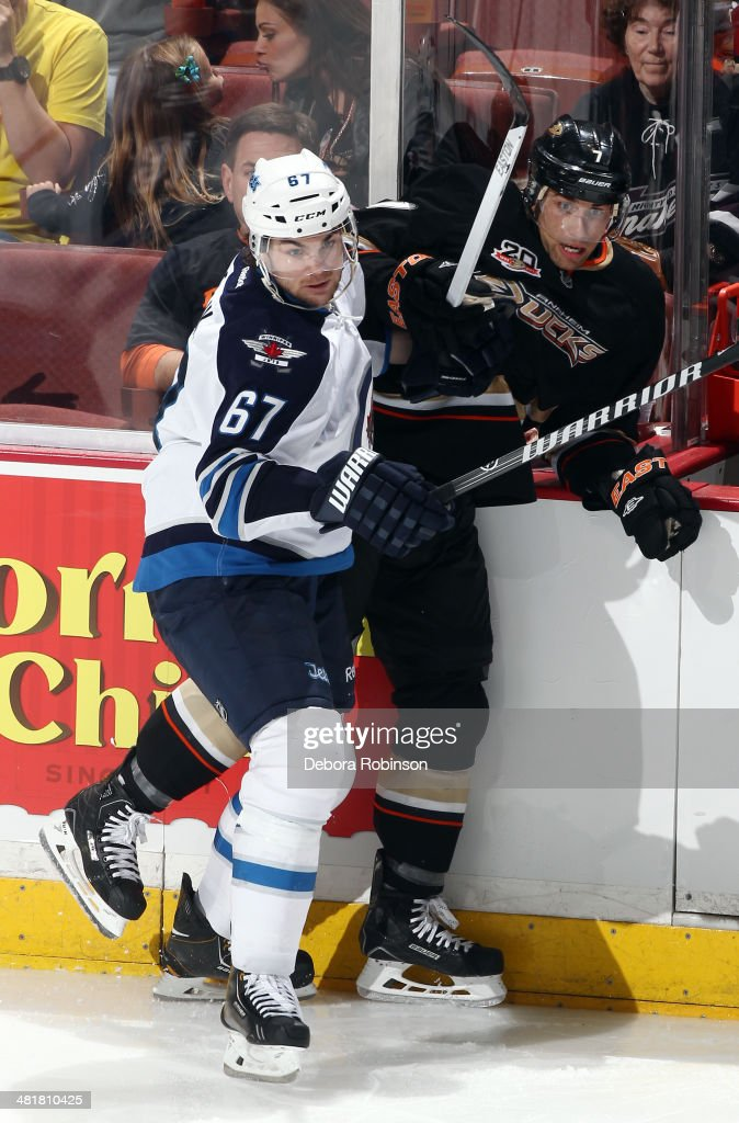 <a gi-track='captionPersonalityLinkClicked' href=/galleries/search?phrase=Michael+Frolik&family=editorial&specificpeople=537965 ng-click='$event.stopPropagation()'>Michael Frolik</a> #67 of the Winnipeg Jets battles for position against <a gi-track='captionPersonalityLinkClicked' href=/galleries/search?phrase=Andrew+Cogliano&family=editorial&specificpeople=869296 ng-click='$event.stopPropagation()'>Andrew Cogliano</a> #7 of the Anaheim Ducks on March 31, 2014 at Honda Center in Anaheim, California.