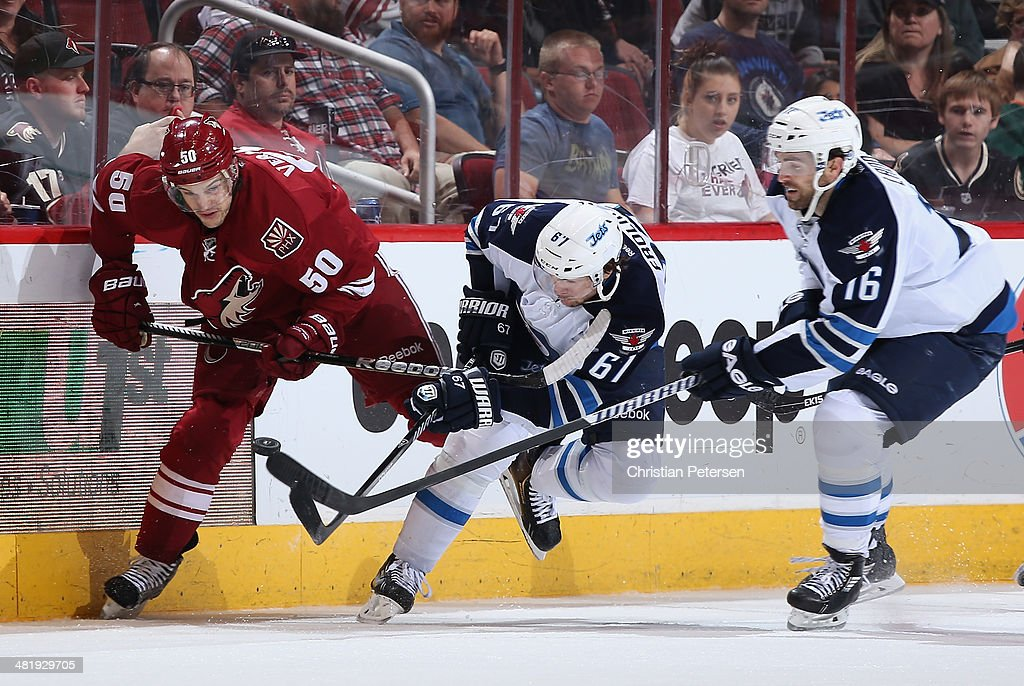 Michael Frolik #67 of the Winnipeg Jets battles for the puck with Antoine Vermette #50 of the Phoenix Coyotes during the third period of the NHL game at Jobing.com Arena on April 1, 2014 in Glendale, Arizona. The Jets defeated the Coyotes 2-1 in an overtime shootout.