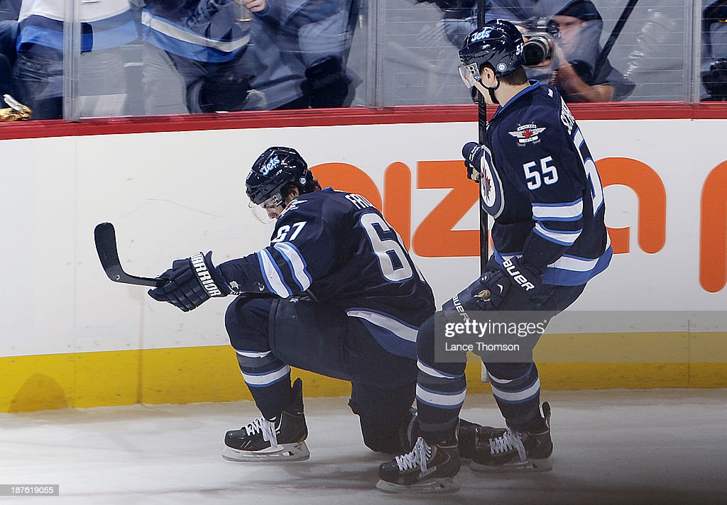 <a gi-track='captionPersonalityLinkClicked' href=/galleries/search?phrase=Michael+Frolik&family=editorial&specificpeople=537965 ng-click='$event.stopPropagation()'>Michael Frolik</a> #67 of the Winnipeg Jets celebrates his second period goal against the San Jose Sharks with teammate <a gi-track='captionPersonalityLinkClicked' href=/galleries/search?phrase=Mark+Scheifele&family=editorial&specificpeople=7342540 ng-click='$event.stopPropagation()'>Mark Scheifele</a> #55 at the MTS Centre on November 10, 2013 in Winnipeg, Manitoba, Canada.