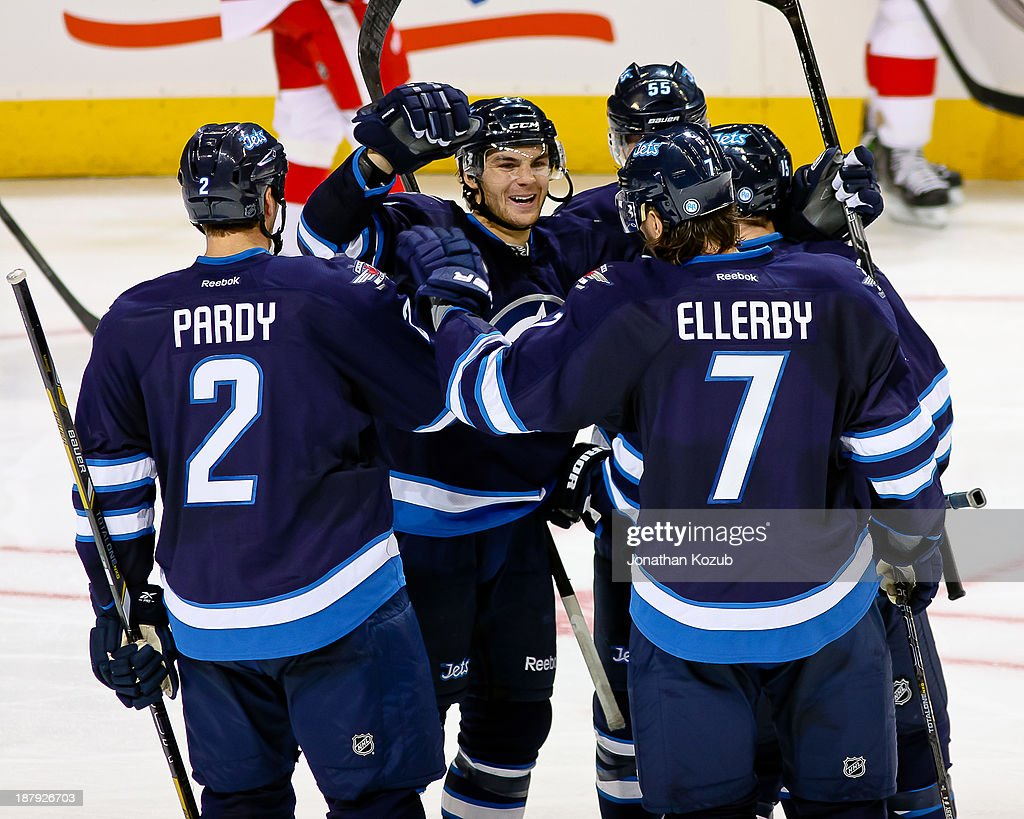 Michael Frolik #67 of the Winnipeg Jets celebrates with teammates Adam Pardy #2, Keaton Ellerby #7, Mark Scheifele #55 and Matt Halischuk #15 a third-period goal against the Detroit Red Wings at the MTS Centre on November 4, 2013 in Winnipeg, Manitoba, Canada. The Jets defeated the Wings 4-2.