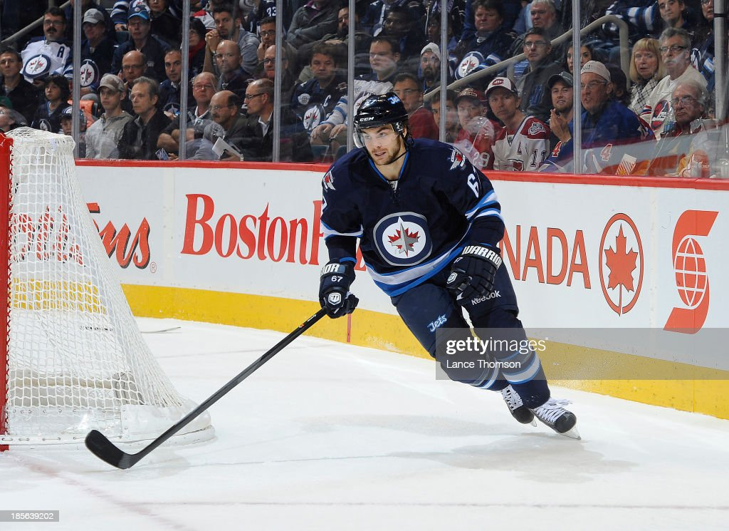 Michael Frolik #67 of the Winnipeg Jets follows the play around the net during first period action against the Montreal Canadiens at the MTS Centre on October 15, 2013 in Winnipeg, Manitoba, Canada. The Habs defeated the Jets 3-0.