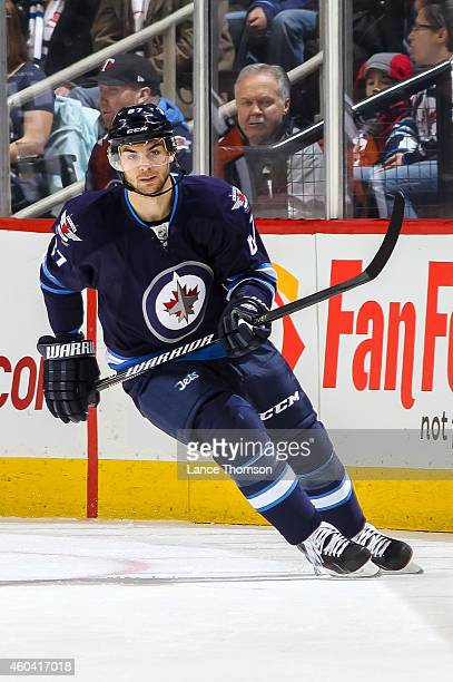 Michael Frolik of the Winnipeg Jets keeps an eye on the play during first period action against the Anaheim Ducks on December 7 2014 at the MTS...