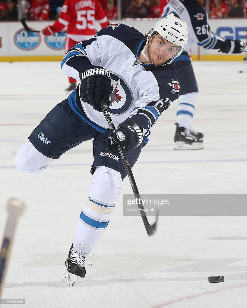 Michael Frolik #67 of the Winnipeg Jets shoots the puck in warm-ups before an NHL game against the Detroit Red Wings at Joe Louis Arena on November 12, 2013 in Detroit, Michigan.
