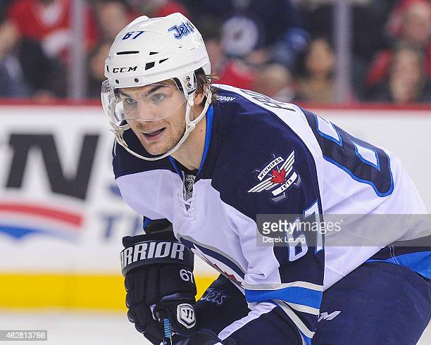 Michael Frolik of the Winnipeg Jets skates against the Calgary Flames during an NHL game at Scotiabank Saddledome on February 2 2015 in Calgary...