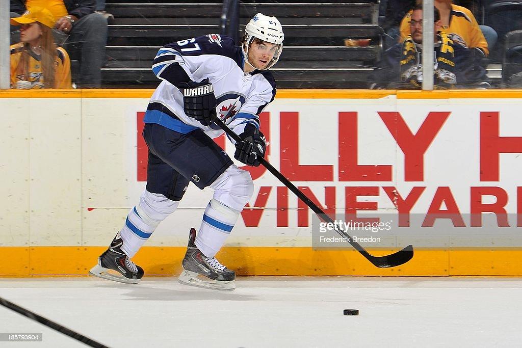 Michael Frolik #67 of the Winnipeg Jets skates against the Nashville Predators at Bridgestone Arena on October 24, 2013 in Nashville, Tennessee.