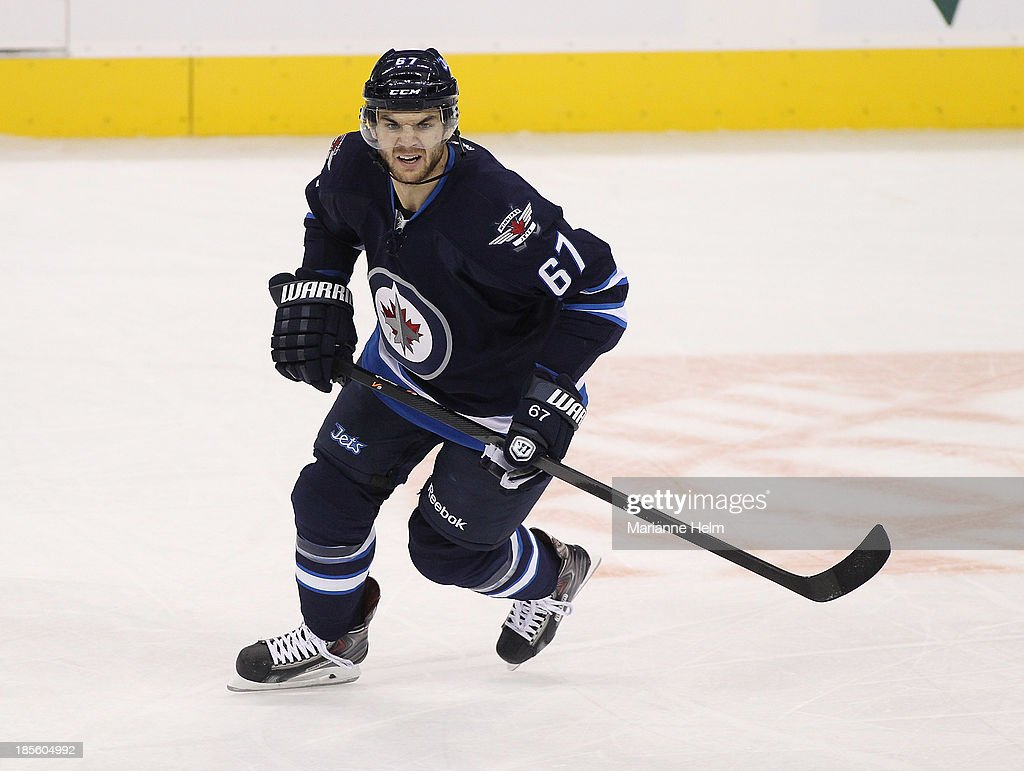 Michael Frolik #67 of the Winnipeg Jets skates during first-period action in an NHL game against the New Jersey Devils at the MTS Centre on October 13, 2013 in Winnipeg, Manitoba, Canada.