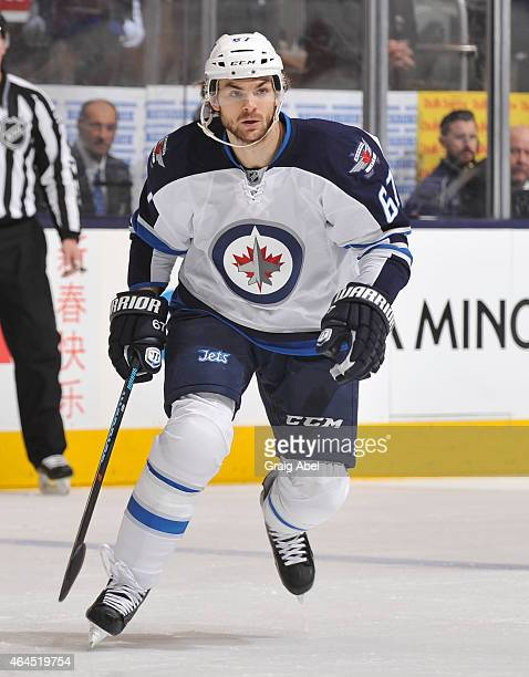 Michael Frolik of the Winnipeg Jets skates during NHL game action against the Toronto Maple Leafs February 21 2015 at the Air Canada Centre in...