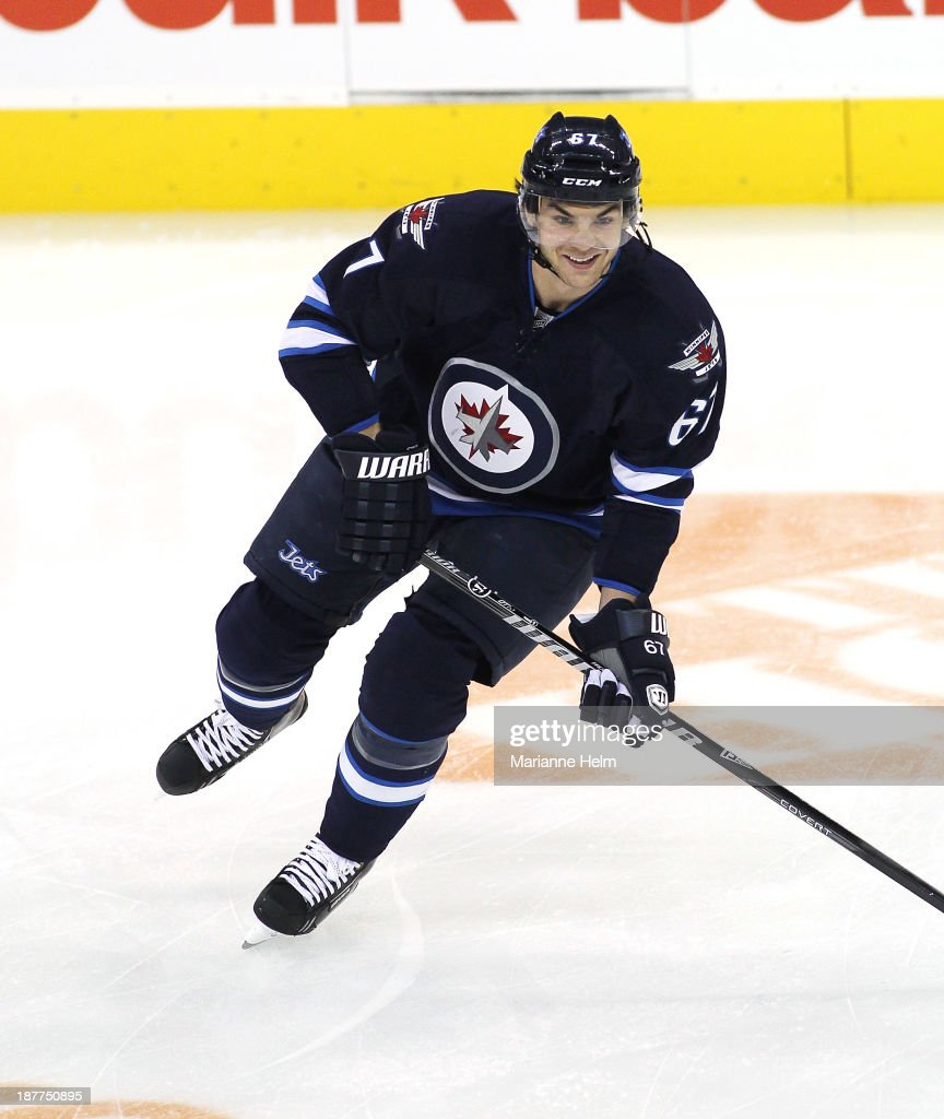 Michael Frolik #67 of the Winnipeg Jets skates during warmup before an NHL game against the Chicago Blackhawks at the MTS Centre on November 2, 2013 in Winnipeg, Manitoba, Canada.