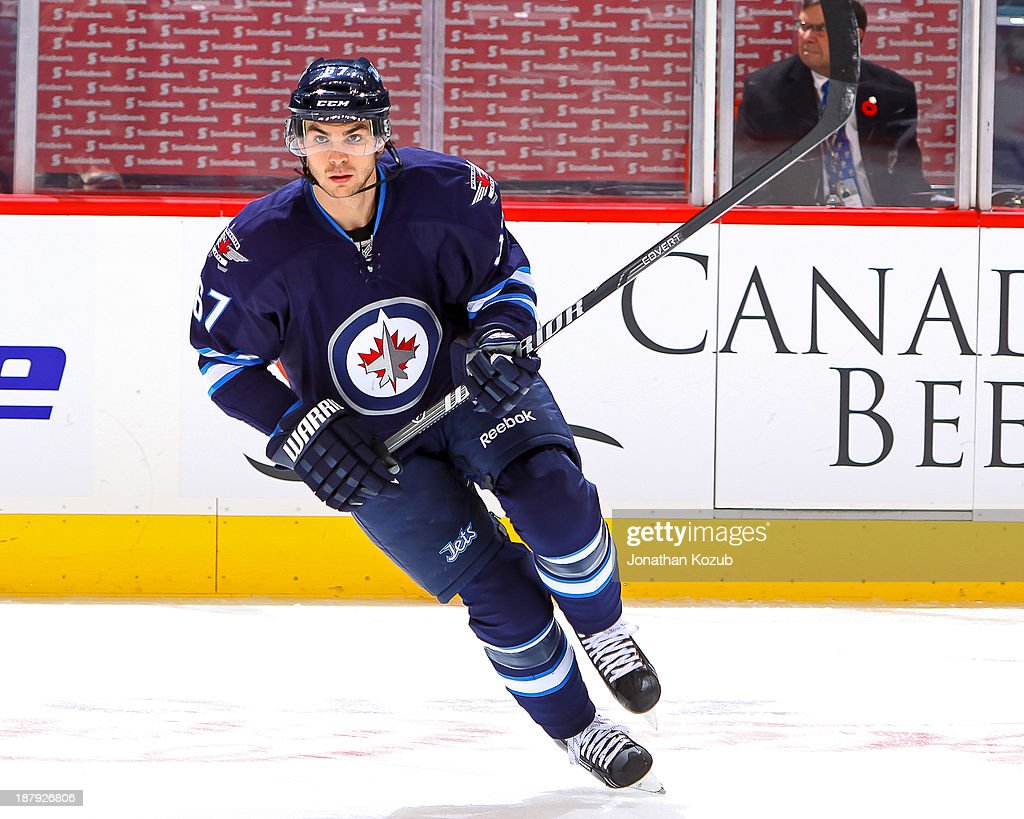 Michael Frolik #67 of the Winnipeg Jets warms up prior to NHL action against the Detroit Red Wings at the MTS Centre on November 4, 2013 in Winnipeg, Manitoba, Canada.