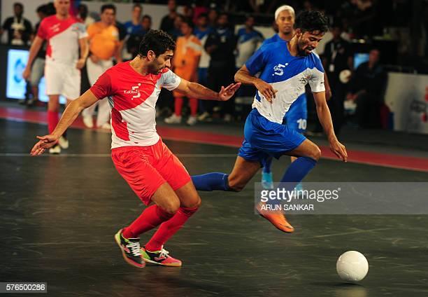 Michael from the Goa 5's plays against Kolkata 5's Gabriel during their Premier Futsal Football League match in Chennai on July 15 2016 / AFP / ARUN...
