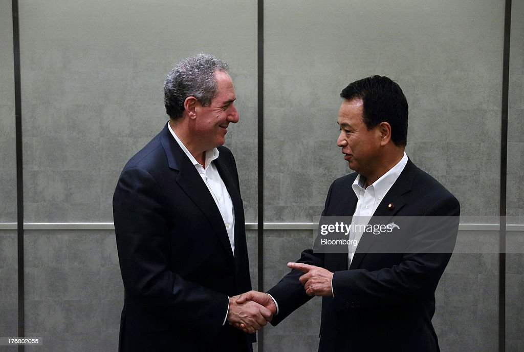 Michael Froman, U.S. trade representative, left, shakes hands with <a gi-track='captionPersonalityLinkClicked' href=/galleries/search?phrase=Akira+Amari&family=editorial&specificpeople=3868034 ng-click='$event.stopPropagation()'>Akira Amari</a>, Japan's minister of state for economic and fiscal policy, during a photo session ahead of their meeting in Tokyo, Japan, on Monday, Aug. 19, 2013. The 11 nations participating in the Trans-Pacific Partnership (TPP) negotiations are seeking to create an economic zone with $26 trillion in annual output. Photographer: Tomohiro Ohsumi/Bloomberg via Getty Images