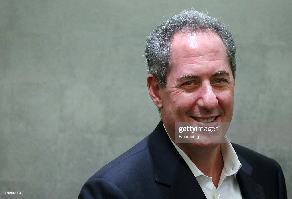 Michael Froman, U.S. trade representative smiles as he shakes hands with <a gi-track='captionPersonalityLinkClicked' href=/galleries/search?phrase=Akira+Amari&family=editorial&specificpeople=3868034 ng-click='$event.stopPropagation()'>Akira Amari</a>, Japan's minister of state for economic and fiscal policy, unseen, during a photo session ahead of their meeting in Tokyo, Japan, on Monday, Aug. 19, 2013. The 11 nations participating in the Trans-Pacific Partnership (TPP) negotiations are seeking to create an economic zone with $26 trillion in annual output. Photographer: Tomohiro Ohsumi/Bloomberg via Getty Images