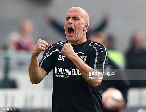 Michael Frontzeckhead coach of Hannover celebrates after the Bundesliga match between Hannover 96 and Werder Bremen at HDIArena on October 3 2015 in...