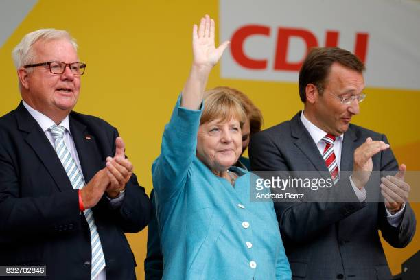 Michael Fuchs German Chancellor and head of the German Christian Democrats Angela Merkel and Josef Oster candidate for the German parliament greet...