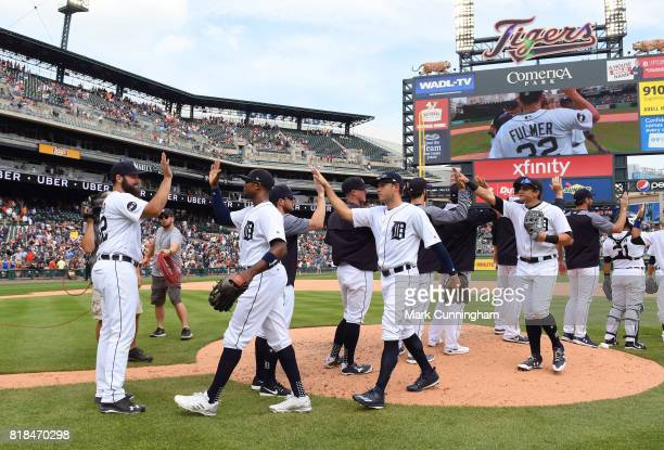 Michael Fulmer of the Detroit Tigers waits to highfive teammates after the victory against the Kansas City Royals at Comerica Park on June 29 2017 in...