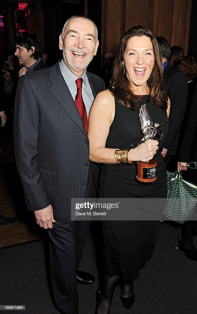 Michael G. Wilson (L) and Barbara Broccoli, winners of Film of the Year for 'Skyfall', attend the London Evening Standard British Film Awards supported by Moet & Chandon and Chopard at the London Film Museum on February 4, 2013 in London, England.