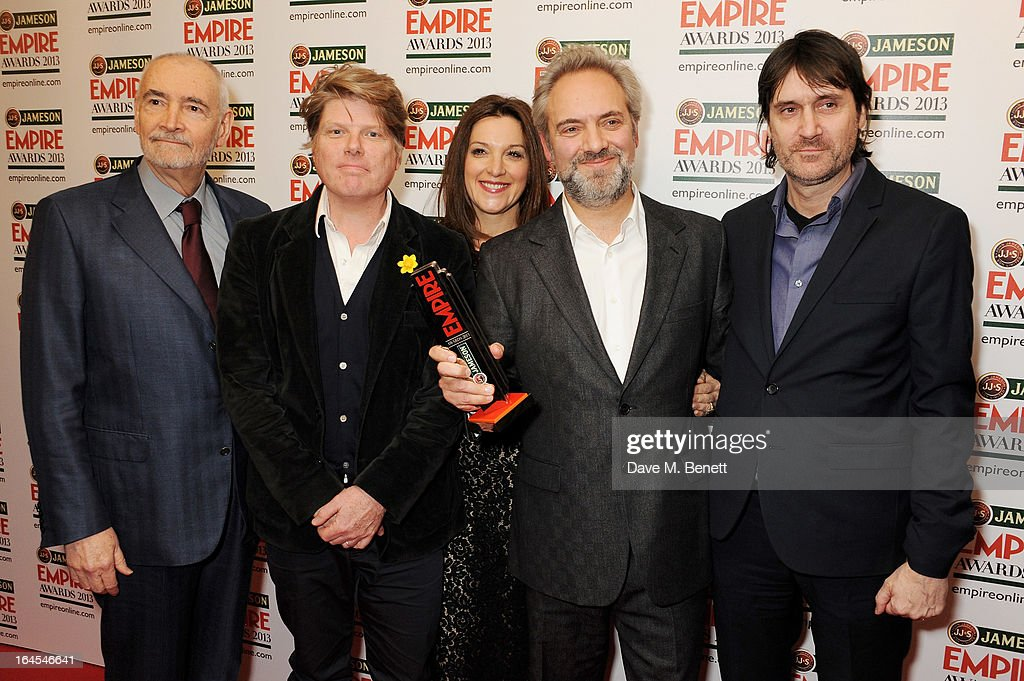 Michael G. Wilson, Robert Wade, Barbara Broccoli Sam Mendes and Neal Purvis pose in the press room with the award for Best Film for 'Skyfall' at the Jameson Empire Awards 2013 at The Grosvenor House Hotel on March 24, 2013 in London, England.
