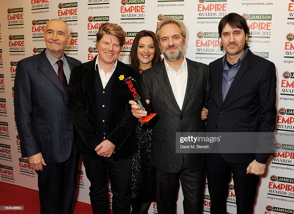 Michael G. Wilson, Robert Wade, Barbara Broccoli, Sam Mendes and Neal Purvis pose in the press room with the award for Best Film for 'Skyfall' at the Jameson Empire Awards 2013 at The Grosvenor House Hotel on March 24, 2013 in London, England.