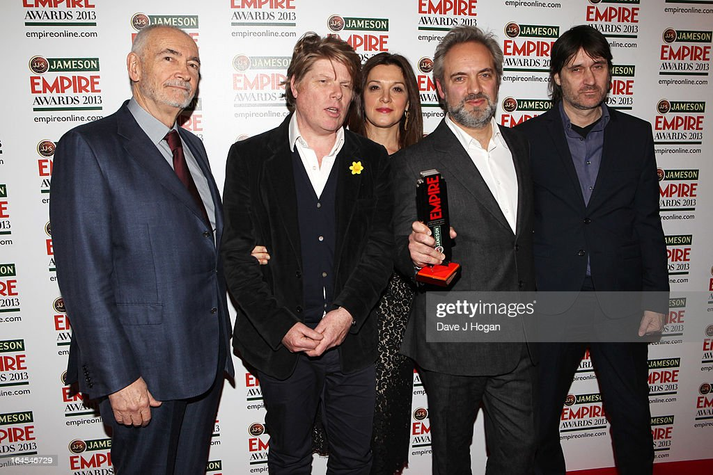 Michael G. Wilson, Robert Wade, Barbara Broccoli Sam Mendes and Neal Purvis pose in the press room with the award for Best Film for 'Skyfall' at the Jameson Empire Awards 2013 at Grosvenor House Hotel on March 24, 2013 in London, England.