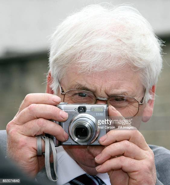 Michael Gallagher who's son Aidan was killed in the Omagh bomb takes a photograph of Detective Sergeant John White as he leaves Letterkenny District...