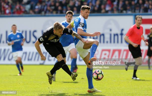 Michael Gardawski of Rostock battles for the ball with Nils Butzen of Magdeburg during the third league match between FC Hansa Rostock and 1FC...