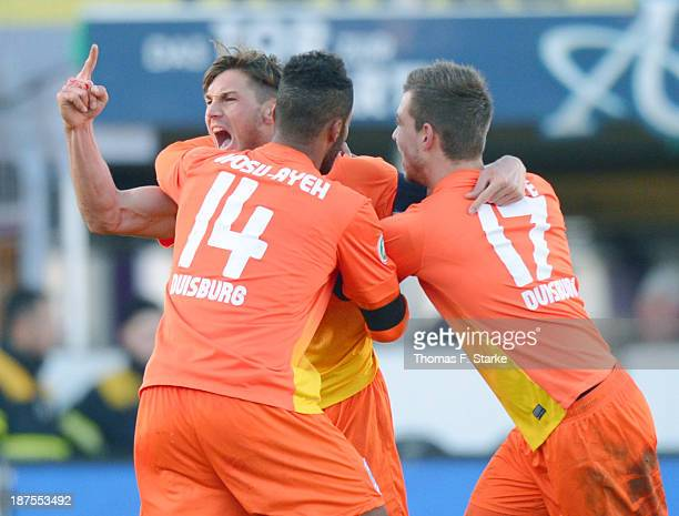 Michael Gardawski Phil Ofosu Ayeh and Kevin Wolze of Duisburg celebrate their teams first goal during the Third League match between between VfL...
