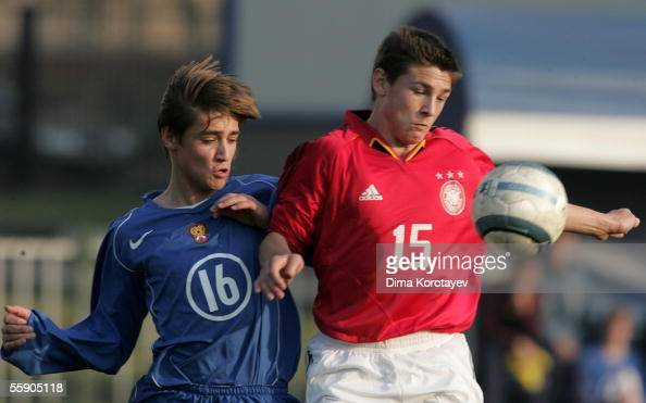 Michael Gardawskiy of Germany vies for the ball with Dmitriy Tarabrikov of Russia during the Under 16 international friendly match between Russia and...