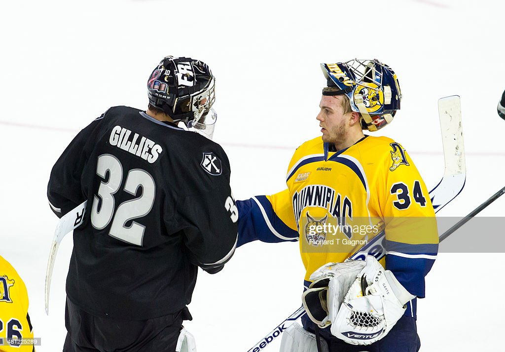 Michael Garteig #34 of the Quinnipiac University Bobcats and Jon Gillies #32 of the Providence College Friars shake hands after the Friars defeated the Bobcats during the NCAA Division I Men's Ice Hockey East Regional Championship Semifinal at Webster Bank Arena on March 28, 2014 in Bridgeport, Connecticut.
