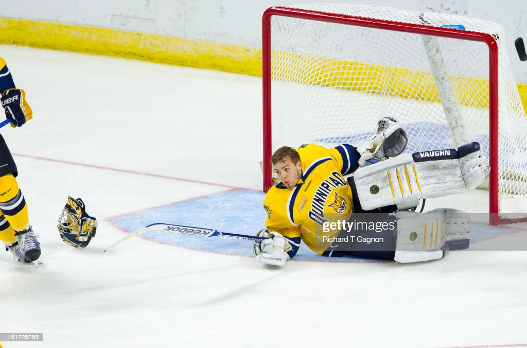 Michael Garteig #34 of the Quinnipiac University Bobcats falls and loses his mask against the Providence College Friars during the NCAA Division I Men's Ice Hockey East Regional Championship Semifinal at Webster Bank Arena on March 28, 2014 in Bridgeport, Connecticut.