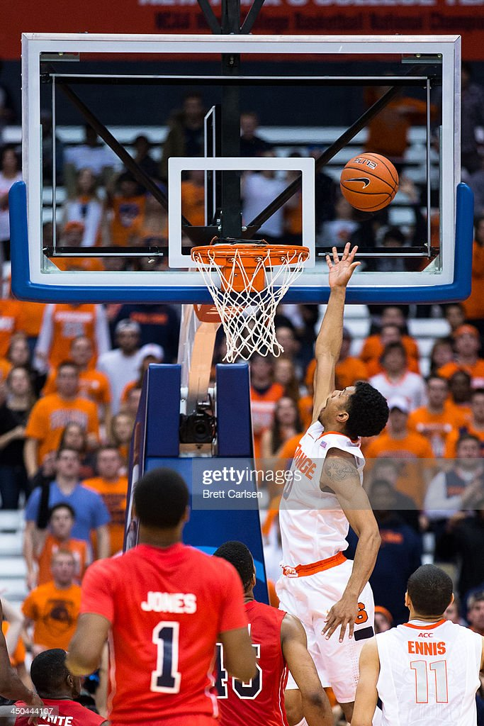 Michael Gbinije #0 of Syracuse Orange lays in a breakaway two points in the second half of a basketball game against St Francis Terriers on November 18, 2013 at the Carrier Dome in Syracuse, New York. Syracuse wins 56-50.