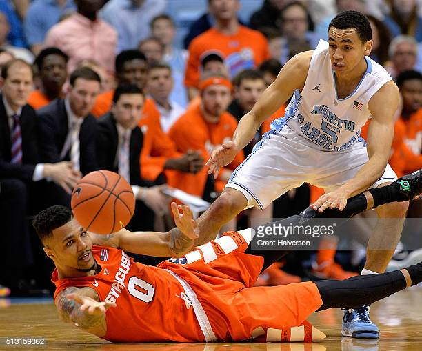 Michael Gbinije of the Syracuse Orange battles Marcus Paige of the North Carolina Tar Heels for a loose ball during a game at the Dean Smith Center...