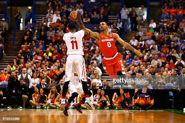 Michael Gbinije of the Syracuse Orange defends Scoochie Smith of the Dayton Flyers in the first half during the first round of the 2016 NCAA Men's...