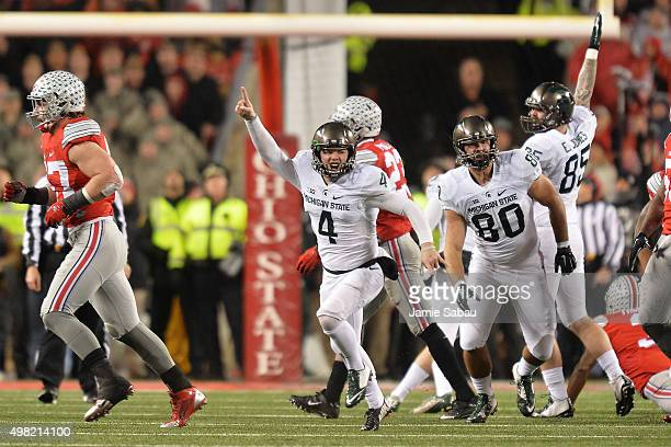 Michael Geiger of the Michigan State Spartans celebrates after kicking a 41yard field goal as time expired against the Ohio State Buckeyes at Ohio...