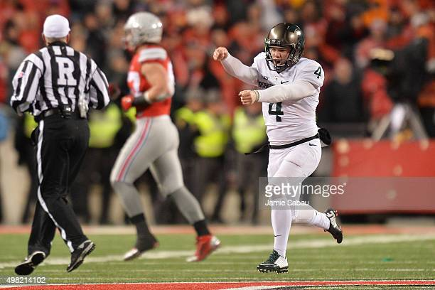 Michael Geiger of the Michigan State Spartans runs up the field celebrating after kicking a 41yard field goal as time expired against the Ohio State...