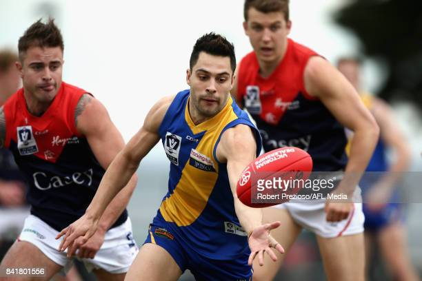 Michael Gibbons of Williamstown gathers the ball during the VFL Qualifying Final match between Williamstown and Casey at Burbank Oval on September 2...