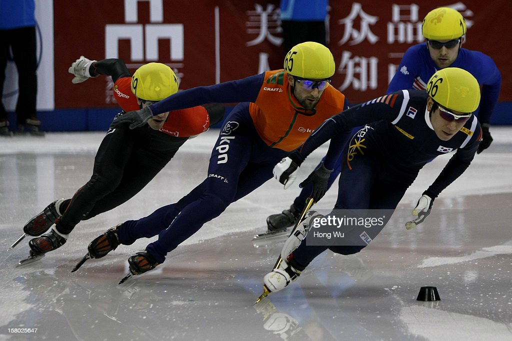 Michael Gilday of Canada, Niels Kerstholt of Netherlands, Paul Stanley of Great Britain, Byeong-Jun Kim of Korea compete in the Men's 5000m Relay Final during the day two of the ISU World Cup Short Track at the Oriental Sports Center on December 9, 2012 in Shanghai, China.