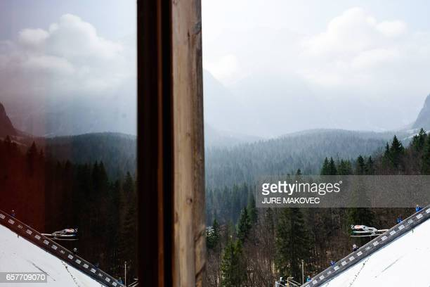 TOPSHOT Michael Glasder of the USA competes during the FIS Ski Jumping World Cup Flying Hill Team Event in Planica Slovenia on March 25 2017 / AFP...